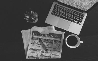 laptop newspaper image